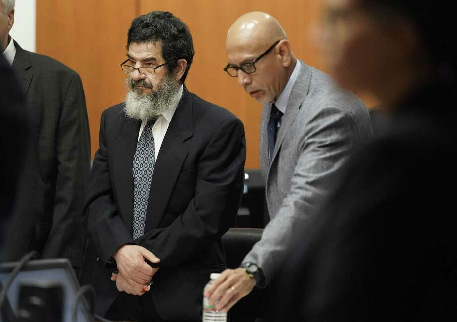 In this June 25, 2018 photo, Ali Mahwood-Awad Irsan, left, stands in court with his defense attorney Rudy Duarte, right, in Houston. Irsan, a 60-year-old Jordanian-American, is charged with capital murder, accused of killing his daughter's husband and her best friend, an Iranian activist.  (Melissa Phillip/Houston Chronicle via AP) Photo: Melissa Phillip, MBO / Associated Press / © 2018 Houston Chronicle