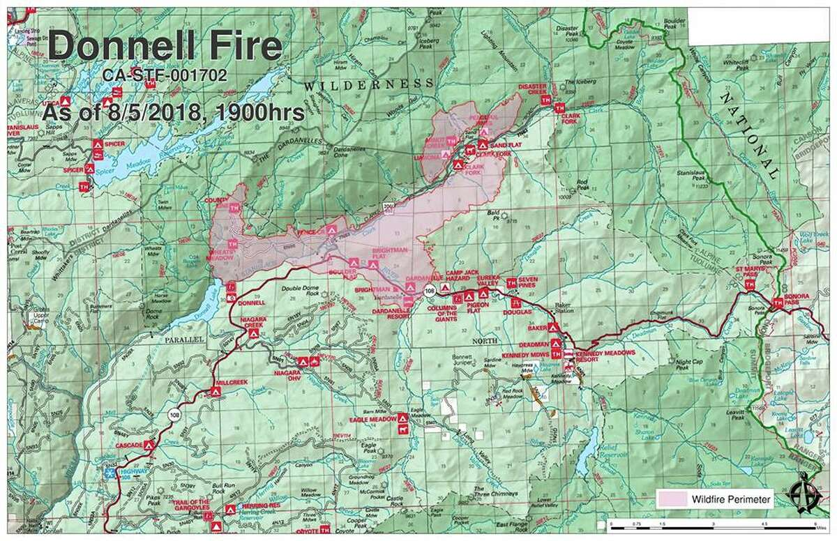 The Donnell Fire has raced across more than 12,000 acres since it started on Aug. 1 on the east side of Donnell Lake. The blaze was 1 percent contained as of Aug. 6.