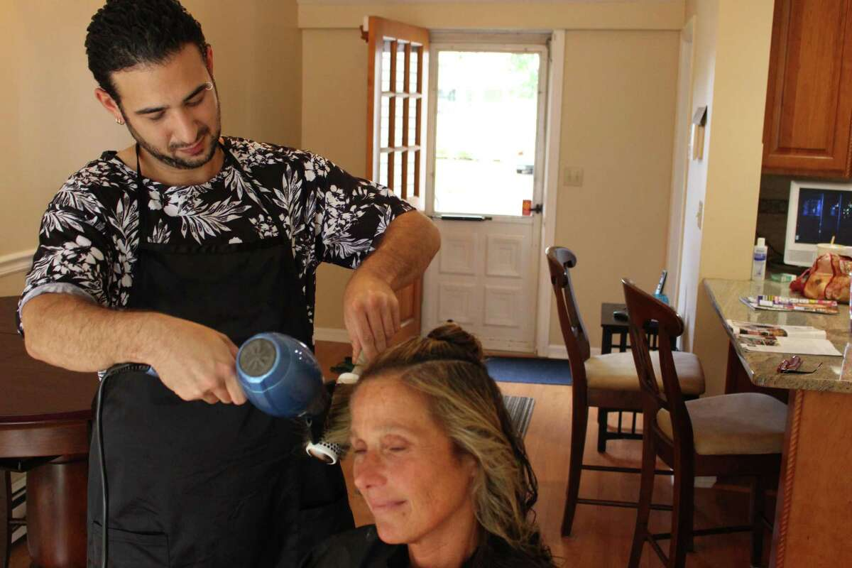 Kevin Anthony working with Fairfield client Sherry Barringer in her dining.