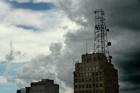 The sky seems nearly split into distinct shelves as a thick layer of dark storm clouds hover atop blue sky over downtown Beaumont. Monday, August 6, 2018 Kim Brent/The Enterprise