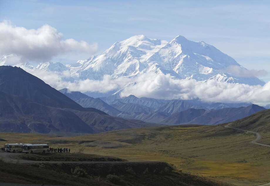 Tourists stop to take in the views of North America's tallest peak, Denali. Four people were killed and one was missing in the crash of a sightseeing plane. Photo: Becky Bohrer / Associated Press 2016