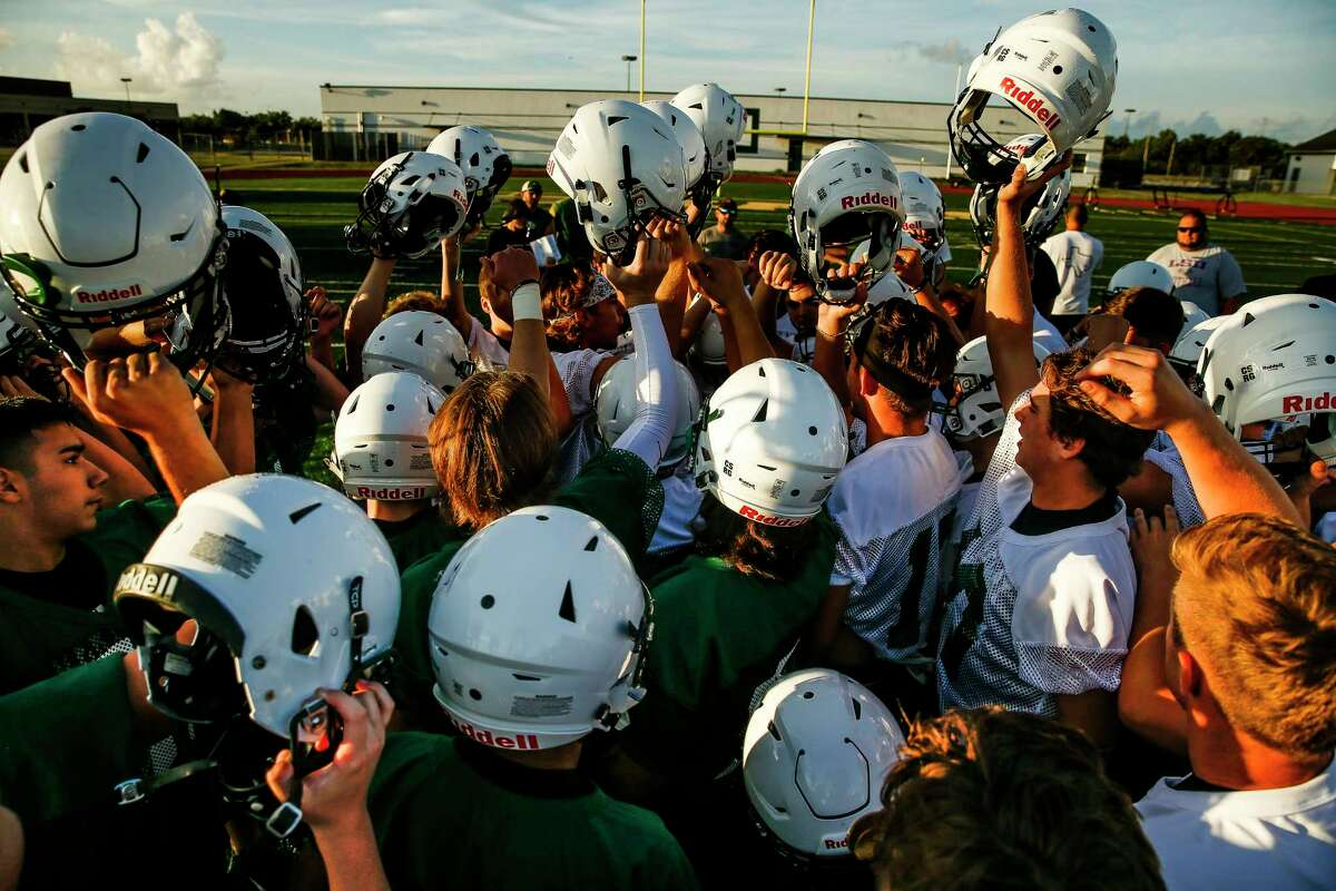 PHOTOS: First day of football practice at Santa Fe High School Santa Fe High School football players cheer before their first practice of the year Monday Aug. 6, 2018 in Santa Fe. Two of the team's players, Christopher Stone and Christian Riley Garcia, were killed last May during the school shooting that claimed the lives of 10 students and teachers. Browse through the photos above for a look at the first day of football practice at Santa Fe High School.