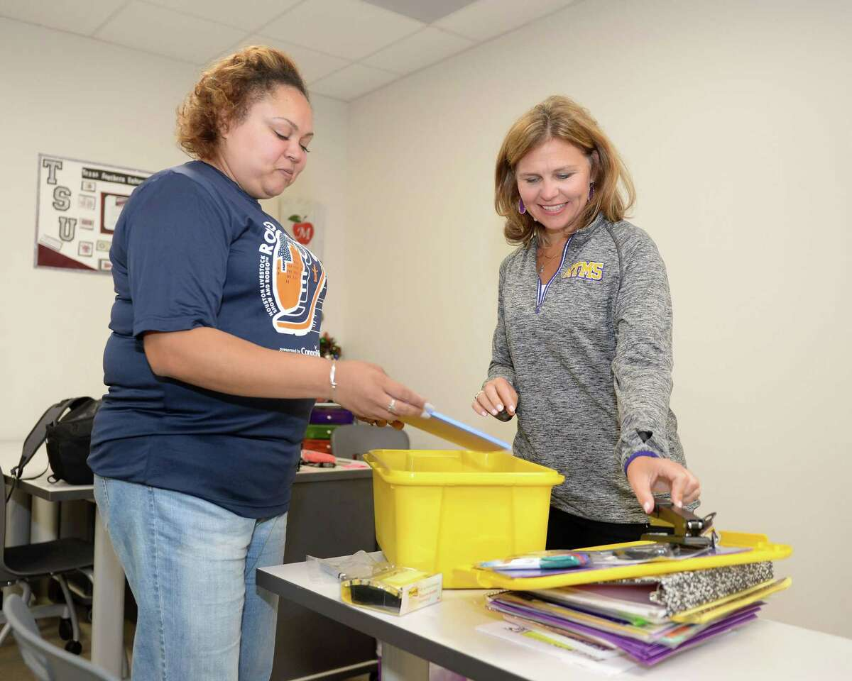 Principal Jeanna Sniffin (right) and Teacher Kurllenne Martin sort through school supplies in preparation for the first day of school at FBISD's Ronald Thornton Middle School, Missouri City, TX, on August 3, 2018