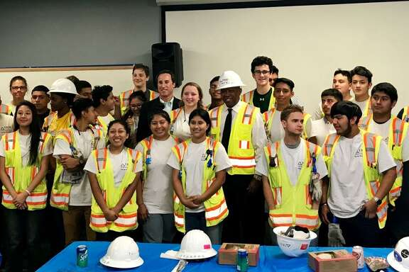 Mayor Turner and Beau Pollock are surrounded by student interns from Spring Branch ISD high schools. The students are part of the initial TRIO Electric Pre-Apprenticeship Program and were honored by Mayor Turner for their work commitment during TRIO Electric Pre-Apprenticeship Partnership Day.