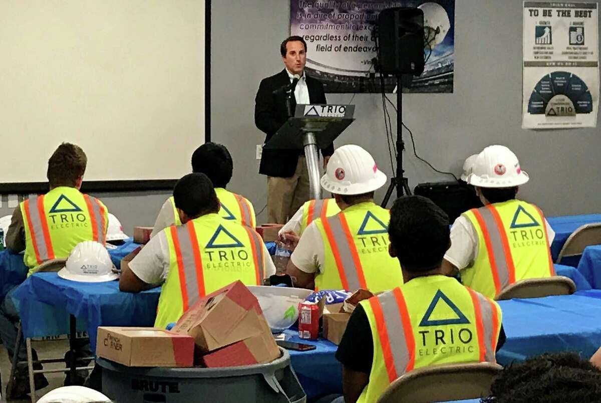 Beau Pollock, president of TRIO Electric, thanks student interns for their work performance on job sites during the summer.