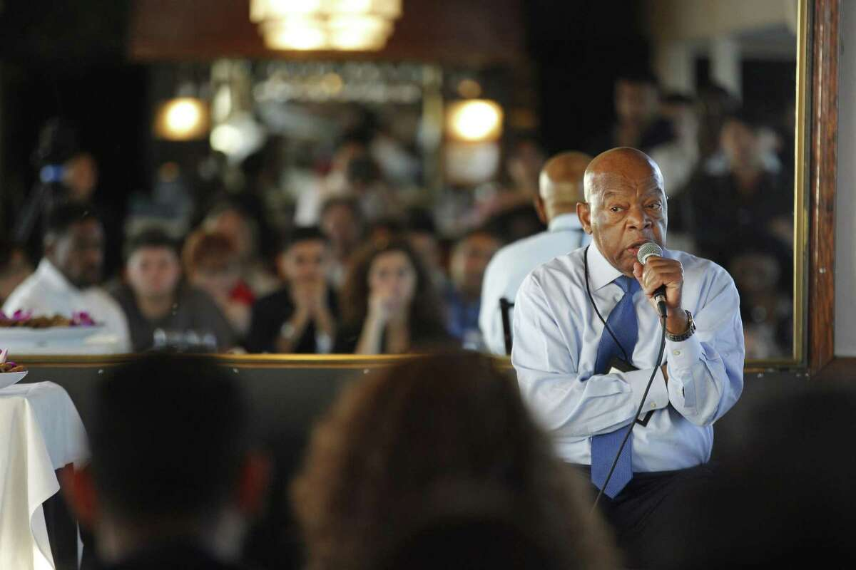 Rep. John Lewis, D-Ga., speaks to 100 student writer-activists from around the world during the inaugural International Congress of Youth Voices in San Francisco.