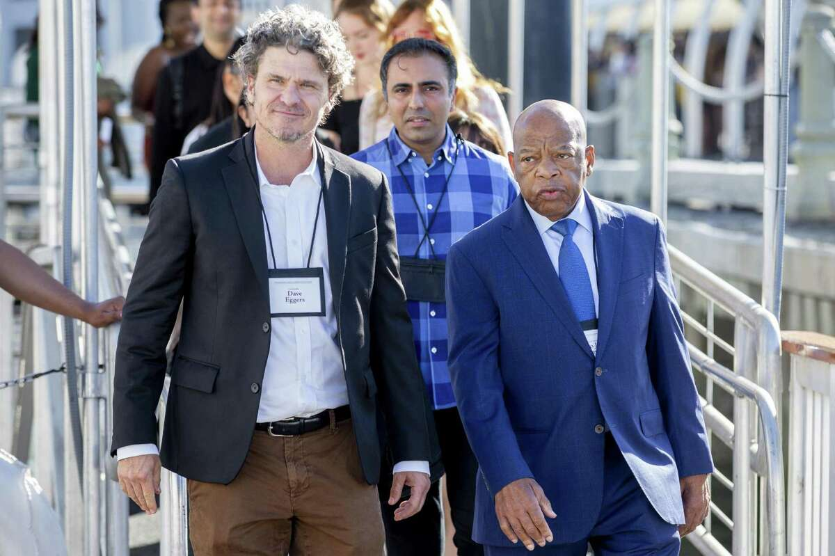 Writer Dave Eggers (left) invited Rep. John Lewis, D-Ga., to address the inaugural International Congress of Youth Voices in San Francisco.