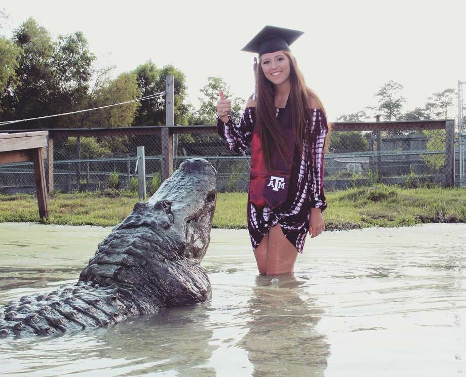 Makenzie Noland poses with Big Tex for her senior portraits at Gator Country in Beaumont. Photo: Provided By Arlie Hammonds
