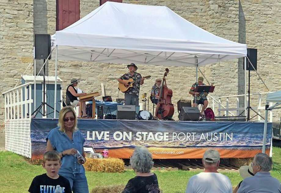 This is a scene from Saturday's Port Austin Farmer's Market, which features live musical performances each week. The Polka Pals -- a newly-formed local musical duo of Ken Wisneski and Terry Ross -- are scheduled to perform at Saturday's market. (Kate Hessling/Huron Daily Tribune)