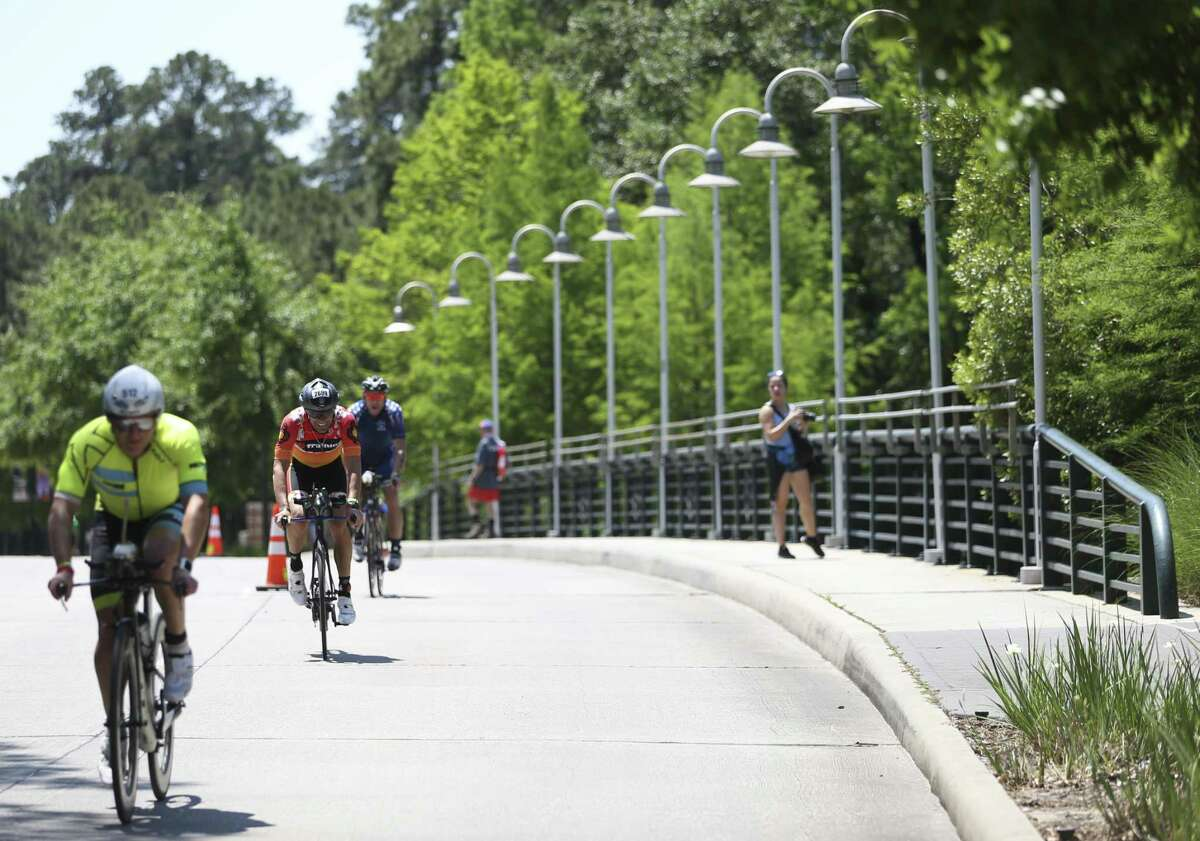 Athletes work their way biking down Six Pines Drive during in the 2018 Memorial Hermann IRONMAN® North American Championship Texas Triathlon on Saturday, April 28, 2018, in The Woodlands. The IRONMAN features 2.4 miles of swimming, 112 miles of biking and 26.2 miles of running. ( Yi-Chin Lee / Houston Chronicle )