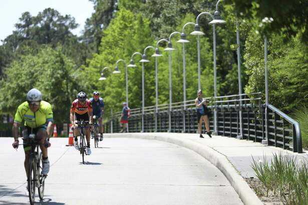 Athletes work their way biking down Six Pines Drive during in the 2018 Memorial Hermann IRONMAN® North American Championship Texas Triathlon on Saturday, April 28, 2018, in The Woodlands. The 2019 event is scheduled for Saturday, April 27.