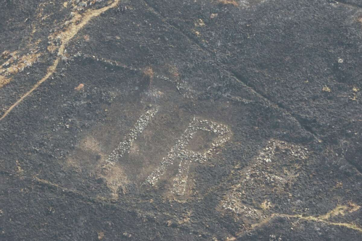 """Airborne members of the Irish police force were surveying wildfire damage over Bray Head when they met an unexpected site: the word """"ÉIRE"""" etched into the rock face."""