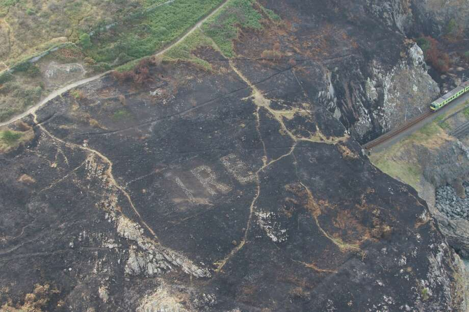 "Airborne members of the Irish police force were surveying wildfire damage over Bray Head when they met an unexpected site: the word ""ÉIRE"" etched into the rock face. Photo: Garda Air Support Unit"