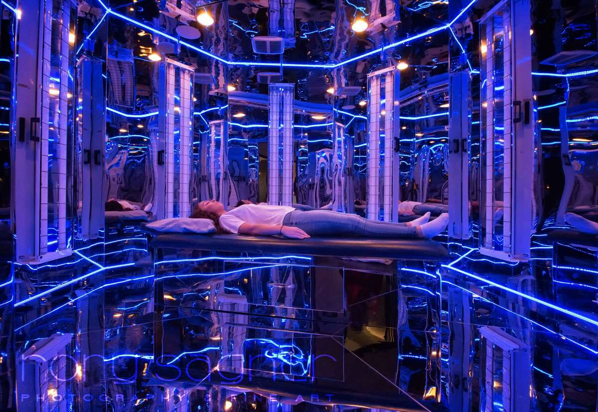 This is the locally shot photo National Geographic selected for Your Shot last month, showing Absolute Health Clinic's Lorena Bensching lying down in the Blu Room. Photographer Rory Sagner of Yelm responded to a call for submissions on