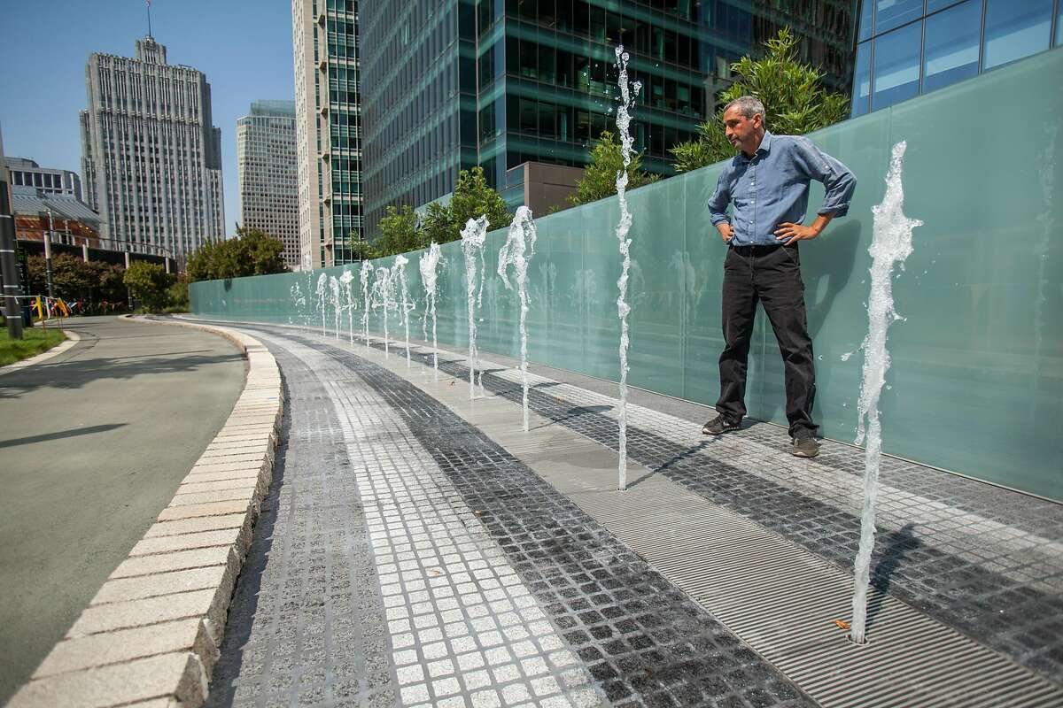 Artist Ned Kahn watches his new Bus Jet Fountain installation at the new Transbay Terminal.