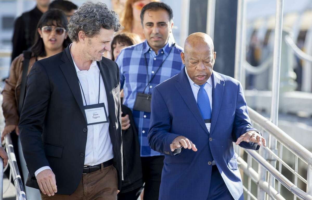 """Writer Dave Eggers (left) invited Rep. John Lewis, D-Ga., who led the """"Bloody Sunday"""" march in Selma, Ala., in 1965, to the inaugural International Congress of Youth Voices in S.F."""