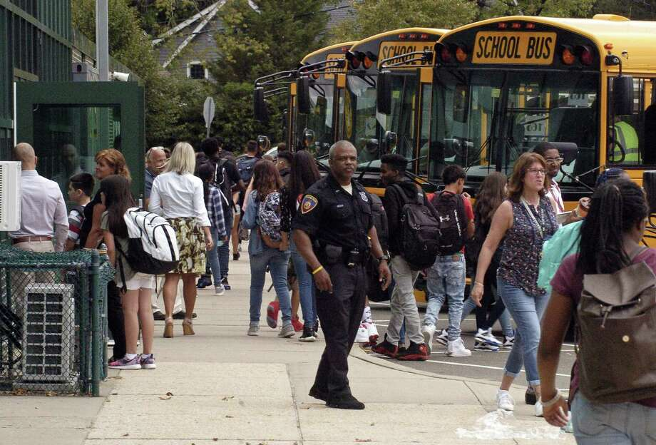 FILE PHOTO — Students scramble to find their bus following the first day of classes at Rippowam Middle School in on Thursday, August 31, 2017. Photo: Matthew Brown / Hearst Connecticut Media / Stamford Advocate