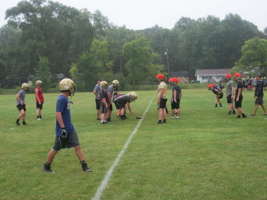 Players take part in a drill during the first day of Bullock Creek football practice on a rainy Monday afternoon at Bullock Creek High School. (Dan Chalk/chalk@mdn.net)