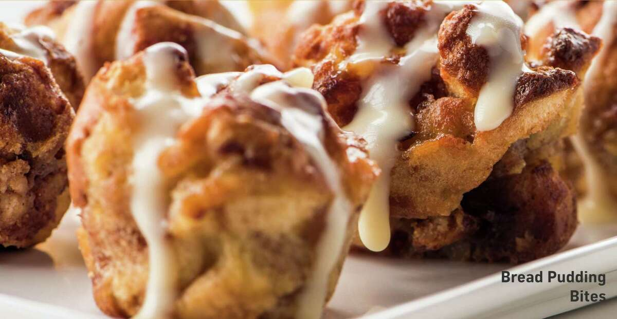 Bread Pudding Bites made with warm bread pudding, whiskey cream sauce and whipped cream are part of the Houston Restaurant Weeks menu at Topgolf-Katy.