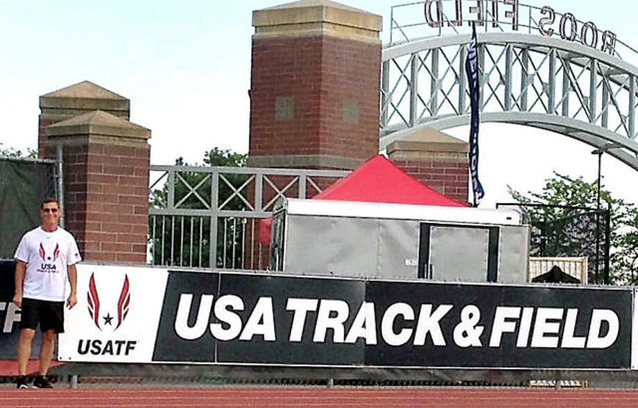 Mike Young of wood Rver pauses at the entrance to Roos Field at Eastern Washington University in Spokane, the site of the recent USA Masters Track and Field Championships. Photo:       Submitted Photo
