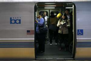 Passengers aboard a San Francisco bound train wait for the doors to close at the 19th Street BART station in Oakland, Calif. on Thursday, Aug. 2, 2018. BART is setting up a bus bridge between the West Oakland station and the 19th Street and Lake Merritt stations during selected weekends in August and September to perform critical track work.