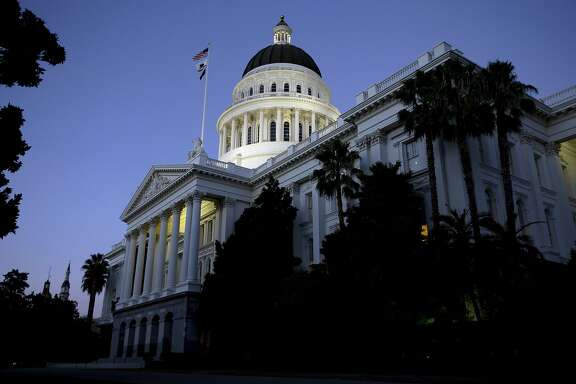 FILE - In this Aug. 31, 2016, file photo, the dome of the state Capitol glows in the early evening in Sacramento, Calif. A federal judge has dismissed the federal government's claim that U.S. law trumps two California laws intended to protect immigrants who are in the country illegally. The ruling by U.S. District Judge John Mendez follows his ruling last week that found California was within its rights to pass two of the three sanctuary laws. Mendez ruled Monday, July 9, 2018, that the federal government could proceed with its attempt to block part of a third California sanctuary law.  (AP Photo/Rich Pedroncelli, File)