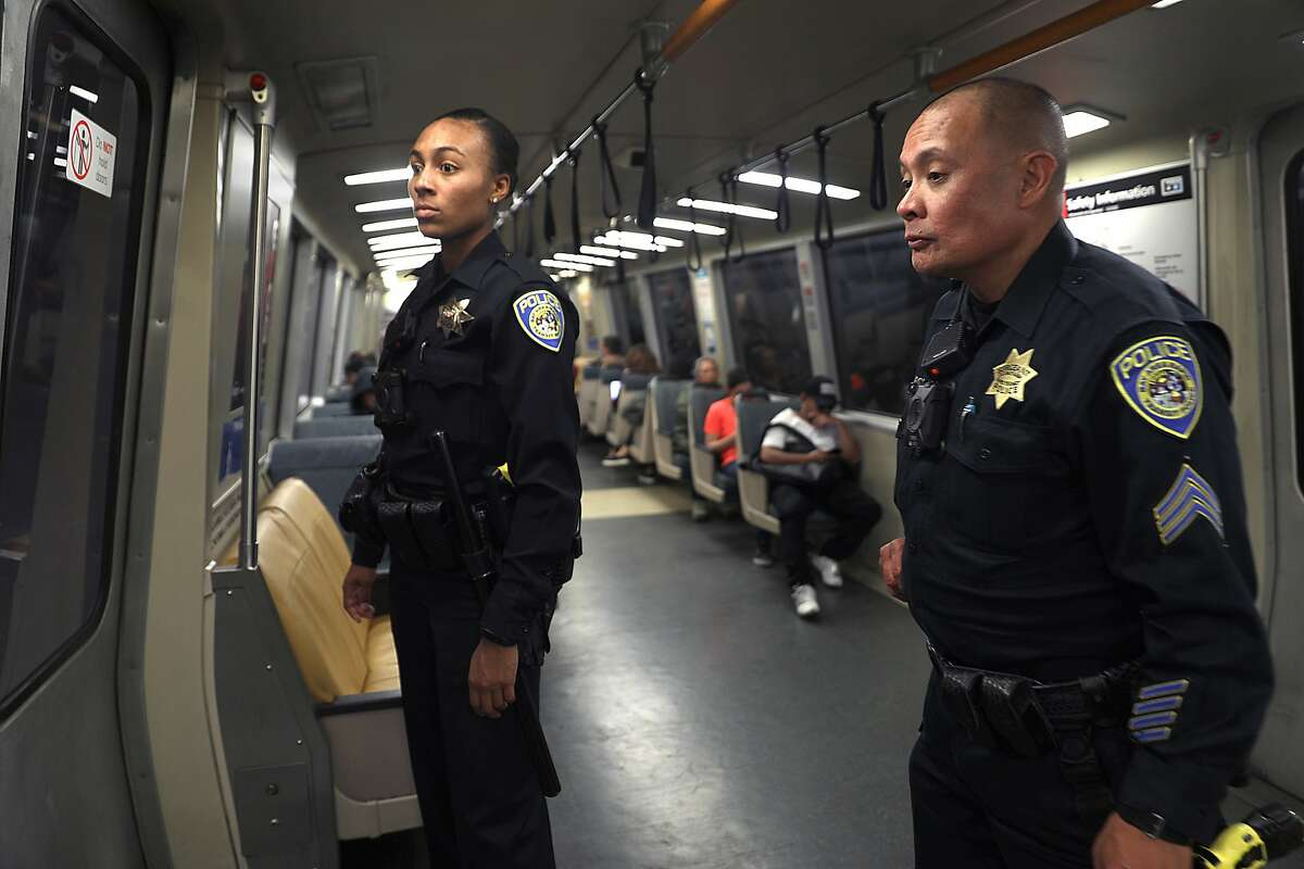 BART officer Cunningham (left) and Sergeant Togonon (right) ride BART from West Oakland station as they start a new public safety plan for the system following a string of high-profile stabbings on Monday, Aug. 6, 2018 in Oakland, Calif. At right is officer Cunningham.