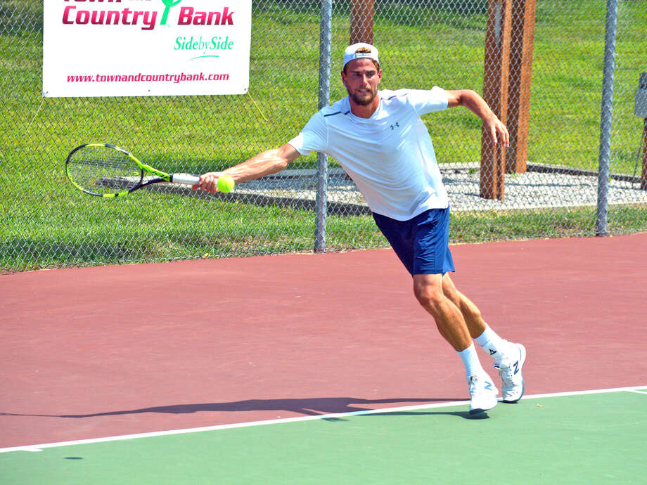 Maxime Cressy of France returns a shot on Monday during his singles match against Charles Broom of Great Britain in the Edwardsville Futures Qualifying Tournament. Photo: Scott Marion