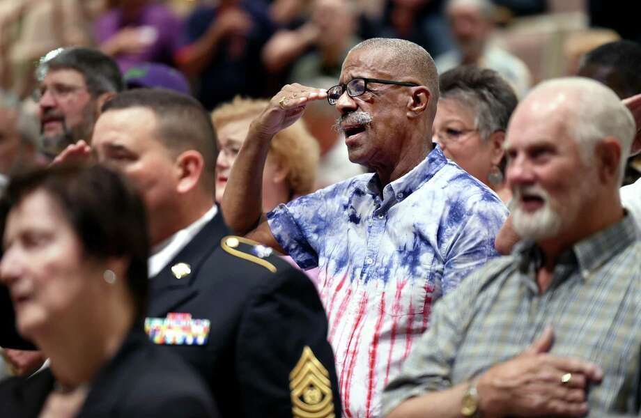 Ronald B. Lewis, center, an Air Force veteran who served from 1964-67, salutes during the Pledge of Allegiance during the Veterans Wartime Service Medal Ceremony at Hamden Middle School Monday. Photo: Arnold Gold / Hearst Connecticut Media / New Haven Register