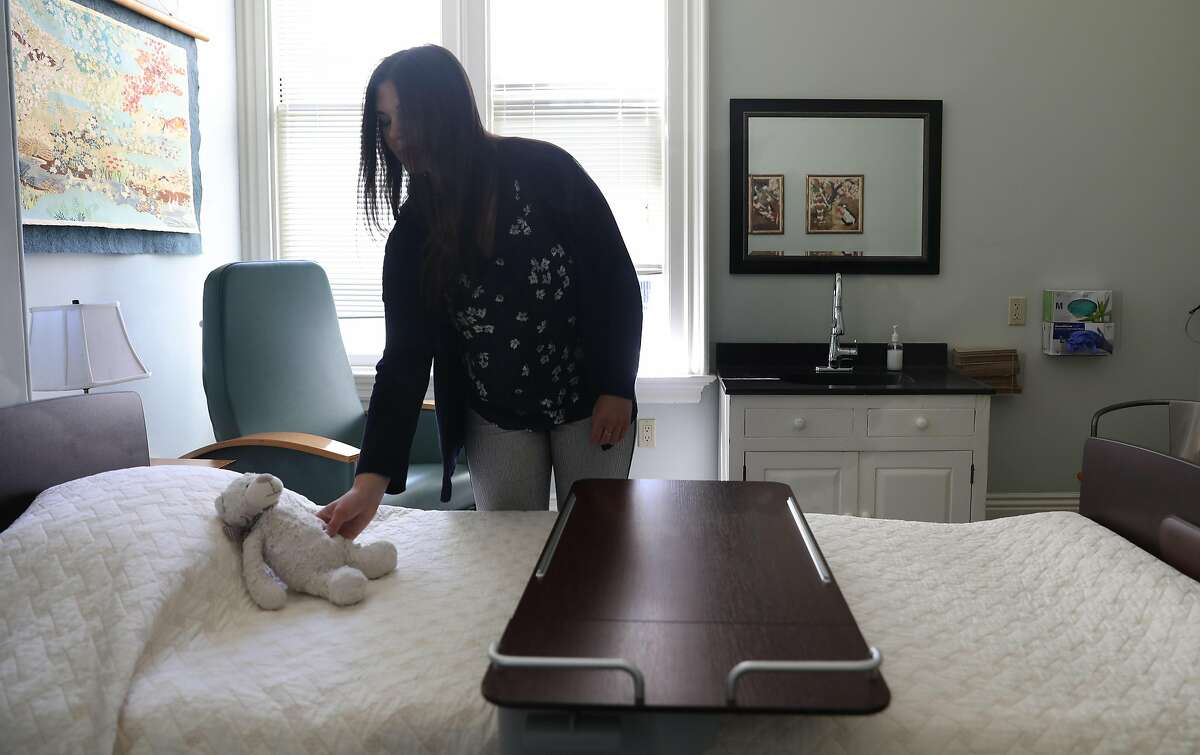 Director of guest house caregiving services Cassie Field shows one of the hospice rooms at the Zen Hospice Guest House on Monday, July 16, 2018 in San Francisco, Calif. The Zen Hospice Guest House which has provided people with a place to die in grace and dignity is shutting down after thirty years due to lack of revenue.