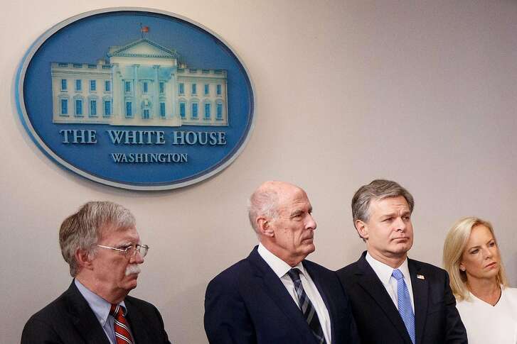 From left: John Bolton, the national security adviser; Dan Coats, the director of national intelligence; FBI Director Christopher Wray and Homeland Security Secretary Kirstjen Nielsen, at a briefing at the White House in Washington, 2, 2018. In blunt terms that the president rarely uses, Trump administration figures said here Thursday that Russia was still trying to influence and disrupt the midterm elections. (Tom Brenner/The New York Times)