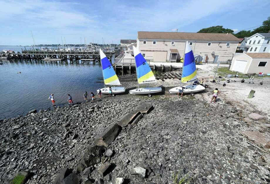 Children in Schooner Camp prepare to launch sailboats into New Haven Harbor on July 31, 2018. Photo: Arnold Gold / Hearst Connecticut Media / New Haven Register