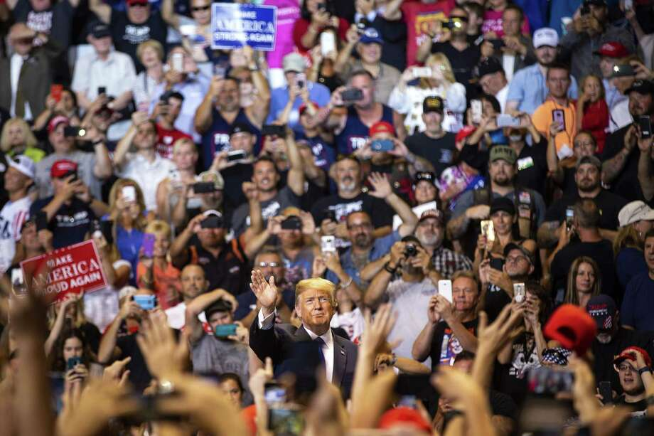 President Donald Trump is cheered by supporters at a rally Thursday in Wilkes-Barre, Pa. Trump devoted the majority of his time targeting the news media, deriding the reporters present as fake, fake disgusting news. Photo: AL DRAGO /NYT / NYTNS