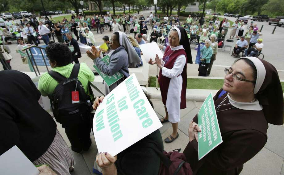 Sister Nohemi Lara CMST, right, of Houston joins close to 200 nuns from San Antonio, Houston, Corpus Christi, Fort Worth and their friends, as they marched to the south steps of the Texas Capitol in Austin to voice their support for the Medicaid expansion on April 17, 2013. This would not be as beneficial as billed. Photo: Bob Owen /San Antonio Express-News / ©2013 San Antonio Express-News