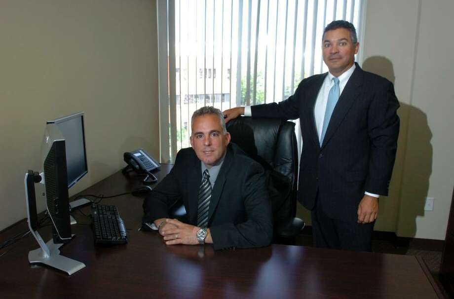 GFI Mortgage in Fairfield, Conn. on Wednesday July 07, 2010. From left to right is: Founder Jeff Vanegle and Managing Director Peter DiDomenico. Photo: Christian Abraham / Connecticut Post