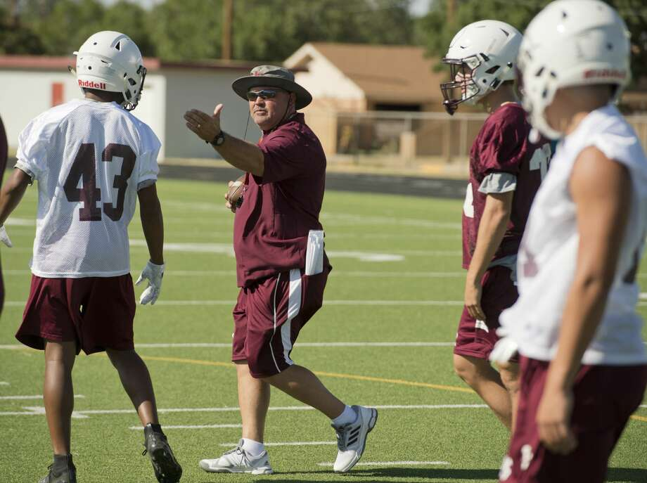 Coach Clint Hartman works with his Lee High players as they run drills 08/06/18 during the evening workout on the first day of practice. Tim Fischer/Reporter-Telegram Photo: Tim Fischer/Midland Reporter-Telegram