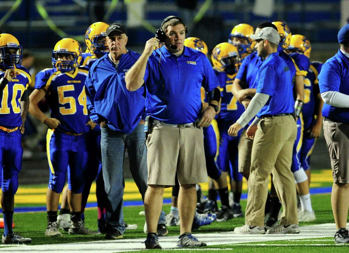 Seymour football coach Tom Lennon has been on paid administrative leave since May, according to multiple sources.