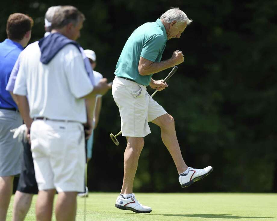 Former New York Gants wide receiver Don Herrmann celebrates sinking a long putt in the 28th annual Tim Teufel Celebrity Golf Tournament at at Tamarack Country Club in Greenwich on Monday. Photo: Tyler Sizemore / Hearst Connecticut Media / Greenwich Time