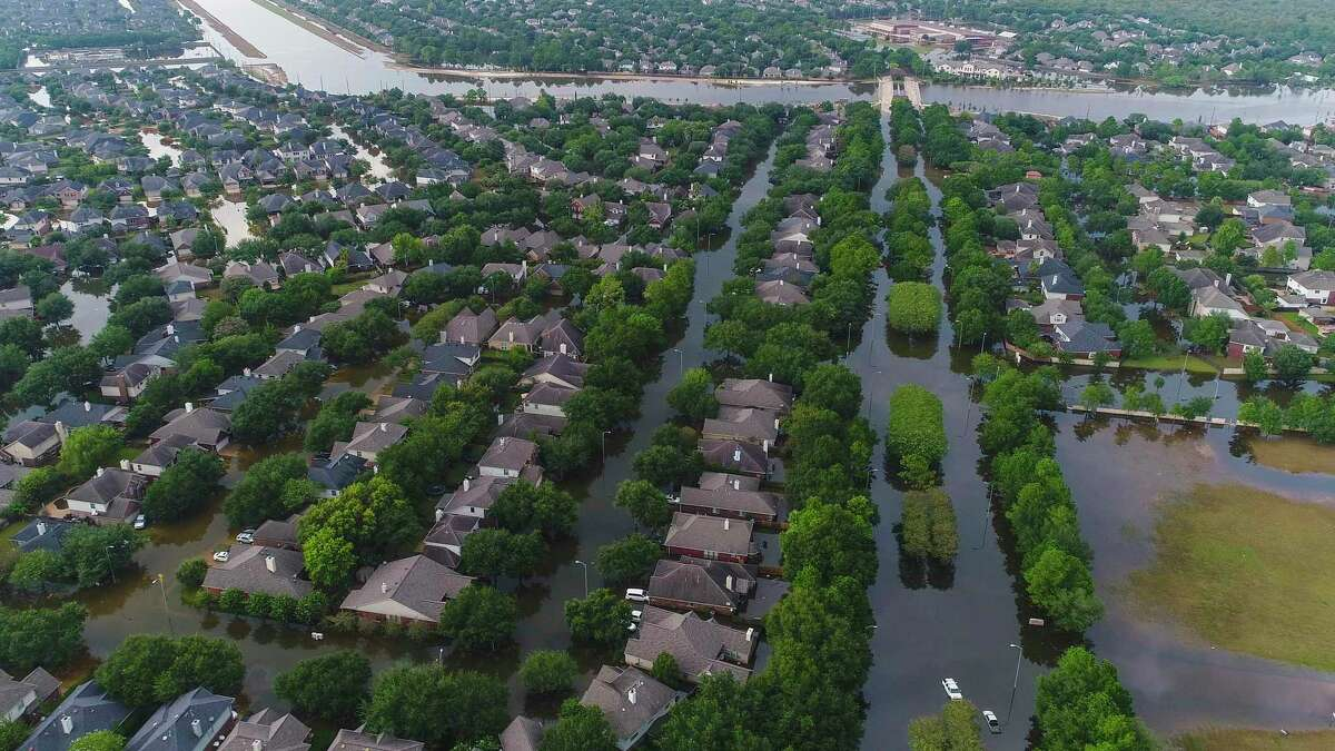Homes in the Cinco Ranch area along S. Mason Road north of the Westpark Tollway are surrounded by water from Barker Reservoir, Saturday, September 2, 2017, in Houston.