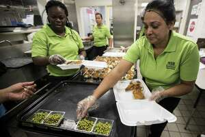 Larie Young, left, and Sonia Herrera prepare meals for the community at Shadydale Elementary School on Wednesday, Sept. 6, 2017, in Houston. The Houston Independent School District is supporting relief efforts in communities across by providing meals to families and individuals affected by the recent floods.  HISDÕs Nutrition Services began serving breakfast, lunch and dinner free of charge at sites in the Houston area.  All nine sites are now open.  The meals will be available on a first-come, first-served basis to all community members. ( Brett Coomer / Houston Chronicle )