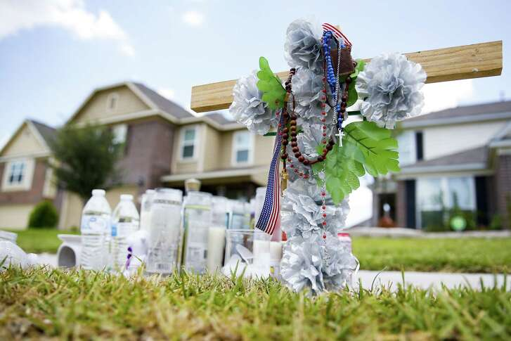 A memorial for Moyses Arreguin sits outside a west Hardy home Wednesday Aug. 1, 2018 in Houston. Arreguin was killed when he tried to break up an attempted robbery outside a neighbors house.