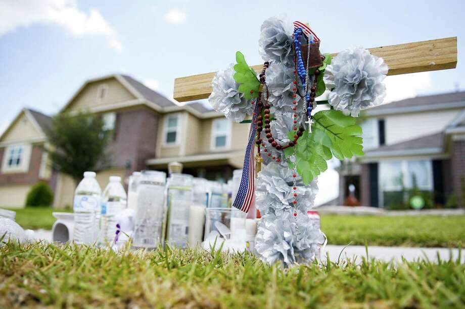 A memorial for Moyses Arreguin sits outside a west Hardy home Wednesday Aug. 1, 2018 in Houston. Arreguin was killed when he tried to break up an attempted robbery outside a neighbors house. Photo: Michael Ciaglo, Staff Photographer / Houston Chronicle / Michael Ciaglo