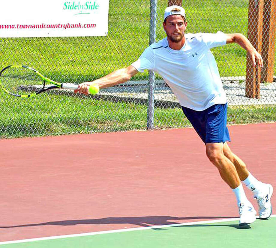 Maxime Cressy of France returns a shot on Monday during his Futures Qualifying Tourney singles match against Charles Broom of the UK at the Edwardsville High Tennis Center. Photo:       Scott Marion | For The Telegraph