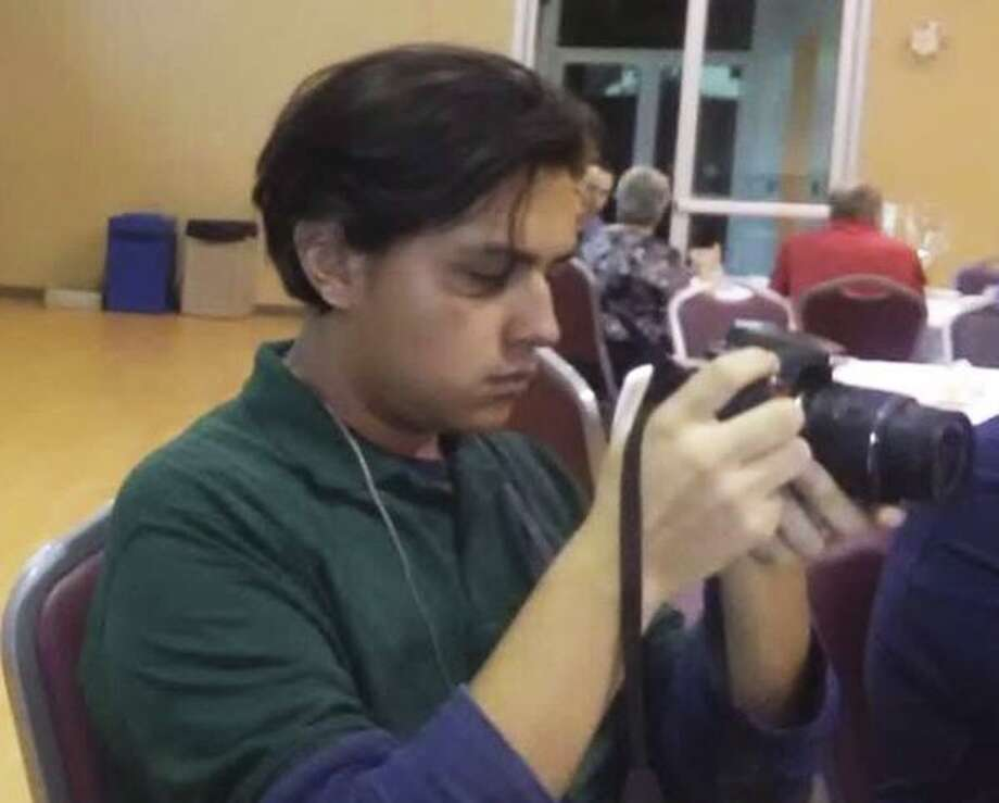 "Sergio Salazar, 18, checks out his camera in this undated photo. Salazar, a student activist known as ""Mapache,"" was arrested Friday, Aug. 3, 2018, in San Antonio by federal agents on an alleged immigration violation after his request for DACA status renewal was denied. He and his supporters say he was targeted in retaliation for calling for the elimination of ICE and protesting the Trump Administration's immigration policy. ICE officials deny that claim. Photo: Courtesy"