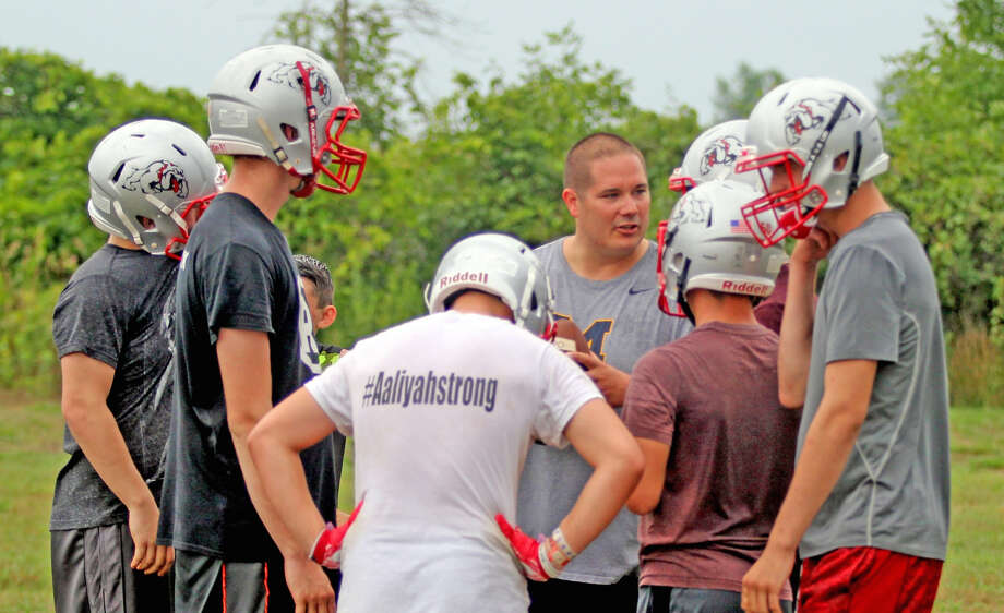 First-year Owendale-Gagetown football coach Nick Gibbard talks with his players during the team's first practice, Monday. Gibbard inherits a program that missed the playoffs for the first time since 2012, going 2-7 in 2017. He hopes to get the Bulldogs back on track in the new NCTL White Division. (Mike Gallagher/Huron Daily Tribune)