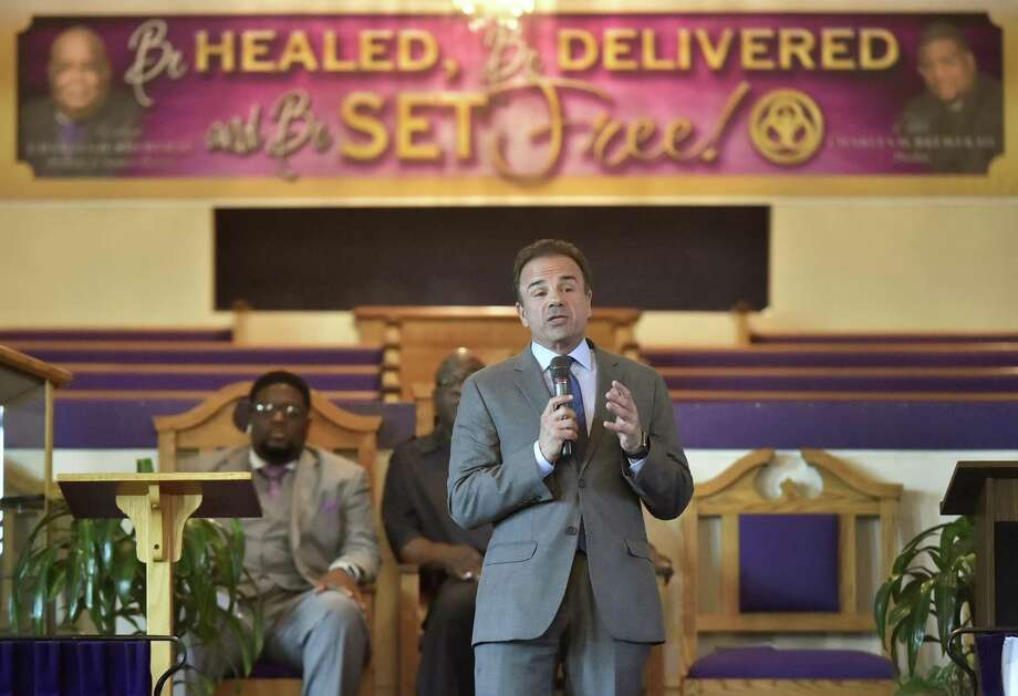 Bridgeport Mayor Joe Ganim answers questions during a gubernatorial candidates forum Monday evening sponsored by the Joshua Generation Clergy Association at the New Trinity Temple Church of God in Christ in New Haven. Behind Ganim are Pastor Charles H. Brewer III of the New Trinity Temple COGIC, left, and the Rev. Boise Kimber of the First Calvary Baptist Church in New Haven. Photo: Peter Hvizdak / Hearst Connecticut Media / New Haven Register