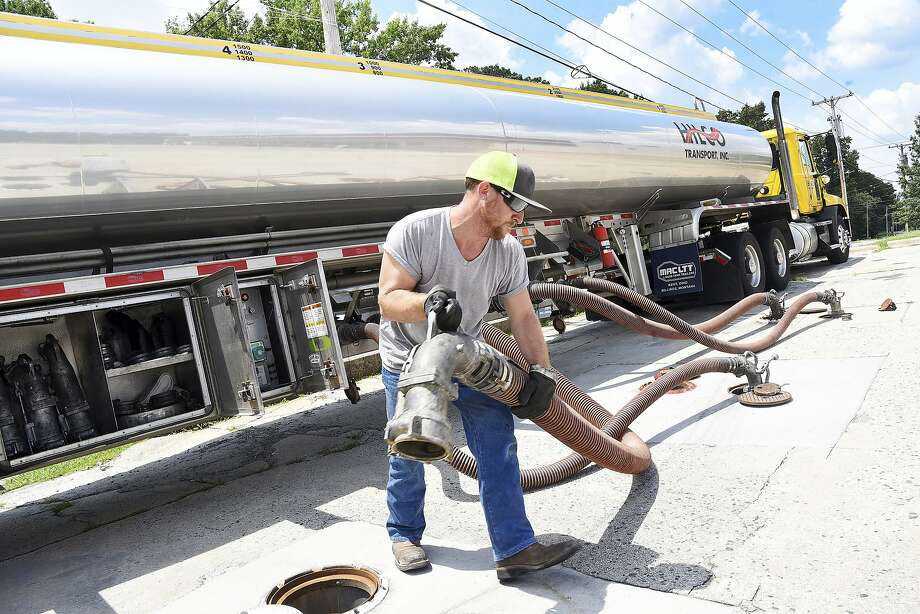 FILE- In this Friday, June 29, 2018, file photo, Colin Hinshaw with Hilco Transport INC. in Greensboro, fills the fuel storage tanks at the Pick N Go gas station in High Point, N.C.  Photo: Laura Greene, Associated Press