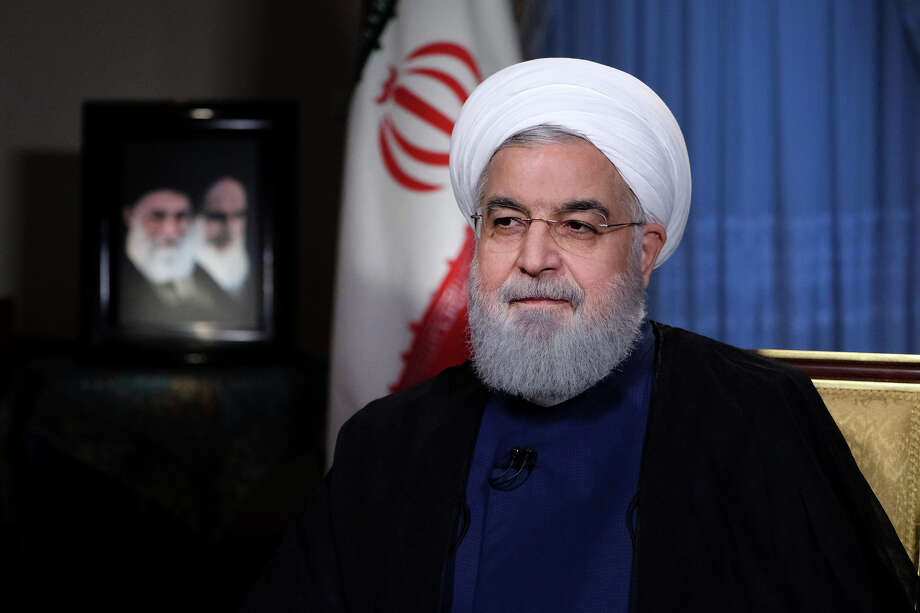 In this photo released by official website of the office of the Iranian Presidency, President Hassan Rouhani addresses the nation in a televised speech in Tehran, Iran, Monday, Aug. 6, 2018. Iranian President Hassan Rouhani struck a hard line Monday as the U.S. restored some sanctions that had been lifted under the 2015 nuclear deal. (Iranian Presidency Office via AP) / Office of the Iranian Presidency