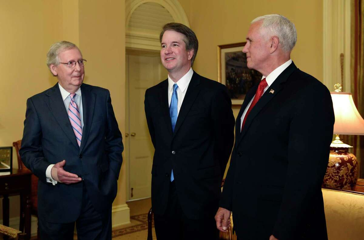 FILE - In this July 10, 2018, file photo, Senate Majority Leader Mitch McConnell of Ky., left, speaks as he talks about Supreme Court nominee Brett Kavanaugh, center, as Vice President Mike Pence, right, listens, during a visit Capitol Hill in Washington. Kavanaugh has paid courtesy calls to 47 senators _ all but one of them Republican _ it?'s becoming increasingly clear President Donald Trump?'s pick for the bench is running up against little resistance to his confirmation this fall.(AP Photo/Susan Walsh, File)