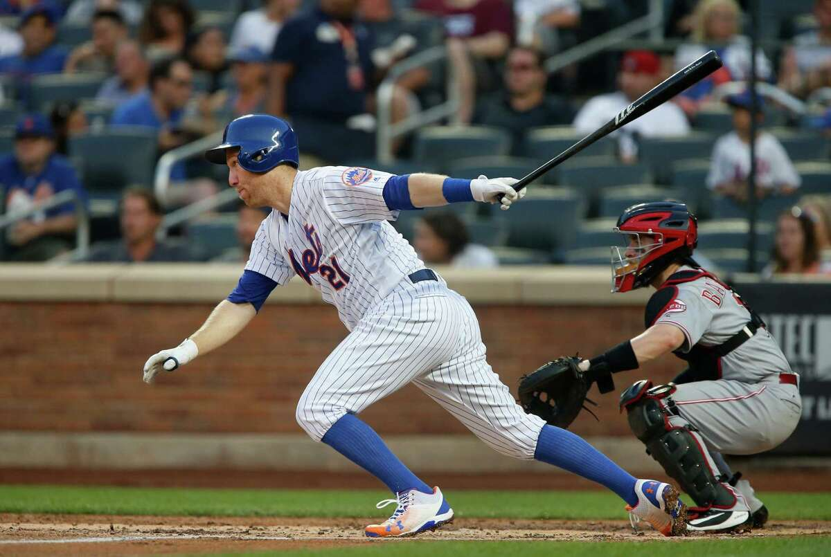 NEW YORK, NY - AUGUST 06: Todd Frazier #21 of the New York Mets follows through on a first inning RBI single against the Cincinnati Reds at Citi Field on August 6, 2018 in the Flushing neighborhood of the Queens borough of New York City. (Photo by Jim McIsaac/Getty Images)